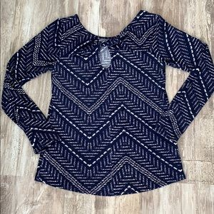 Super cute top with great twist detail in the back